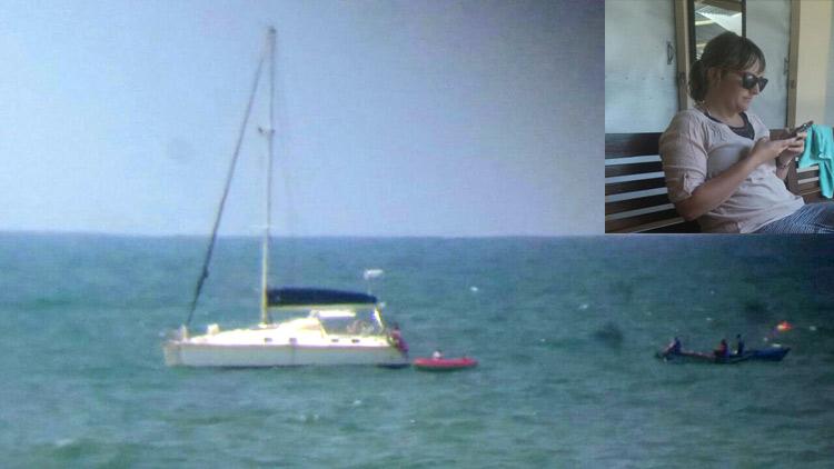 kapal layar yang ditumpangi warga Australia berhenti di perairan Pantai Baron menurunkan salah satu penumpang. insert: ABK kapal yang turun, Stephaie Kathleen. dok: Tim SAR.